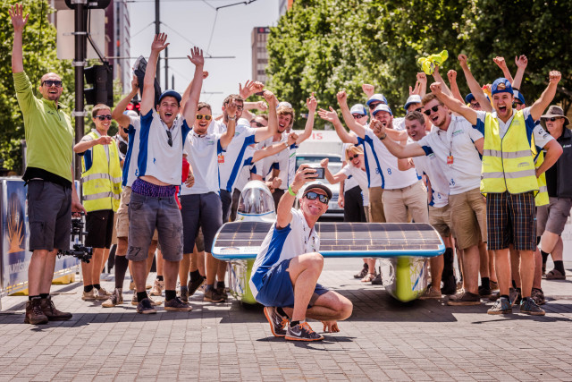 The Belgian Punch Powertrain Solar Team carry their car as they cross the finish line of the 2015 World Solar Challenge in Adelaide, Australia, on Thursday, Oct. 22, 2015. The Belgian team finished fifth out of 45 teams from 25 different countries in a 3,000 km race for solar cars from Darwin to Adelaide.  PHOTO - PUNCH POWERTRAIN SOLAR TEAM / GEERT VANDEN WIJNGAERT
