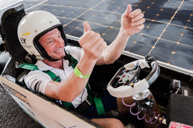 Driver Bert Longin smiles and cheers as he sits in the Belgian Punch Powertrain Solar Team car after the qualification lap for the 2015 Bridgestone World Solar Challenge at Hidden Valley race track in Darwin, Australia, on Saturday, Oct. 17, 2015. The team of 16 University of Leuven students set the 4th time and will start on Sunday, together with 44 other solar cars from 25 different countries for a 3,000 km race from Darwin to Adelaide. PHOTO - PUNCH POWERTRAIN SOLAR TEAM / GEERT VANDEN WIJNGAERT