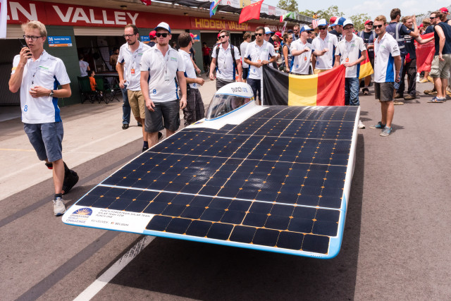 Team members gather around the Belgian Punch Powertrain Solar Team car ahead of the qualification lap for the 2015 Bridgestone World Solar Challenge at Hidden Valley race track in Darwin, Australia, on Saturday, Oct. 17, 2015. The team of 16 University of Leuven students set the 4th time and will start on Sunday, together with 44 other solar cars from 25 different countries for a 3,000 km race from Darwin to Adelaide. PHOTO - PUNCH POWERTRAIN SOLAR TEAM / SARAH SOMERS